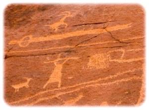 Petroglyphs including atlatl